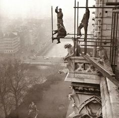 Workers on rickety scaffolding during the restoration of Notre Dame, Paris, 1952