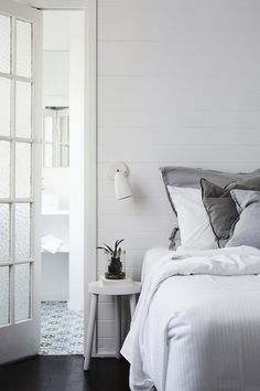 Soft grey in the bedroom in the cottage at The Bower, Byron Bay (luxury boutique design hotel).
