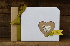 I've been drawn to negative die cuts lately. Love the buttons peeking out from the heart on this one.
