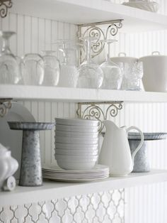 Decorative Shelving Options :: Beaded board behind these open shelves adds to this kitchen's cottage charm. Everyday items such as bowls and plates are stored on the lower shelves, while infrequently used items are stored on the upper shelf. Although the shelves answer the call for simplicity, the lacy scrollwork brackets add a touch of ornamentation. | via BHG