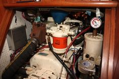 Our trusty 30 hp 4 cyl Nanni Kubota diesel - note the extra racor water/fuel separator before the fuel filter and the vacuum gauge altering us that the filter needs changing.