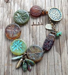 "DragonFly Feathers Quartet:  Patina on lightest ""dragonfly"" and the brass button"