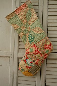 Large Antique Quilt Stocking Cottage Chic Upcycled Vintage Materials. $29.00, via Etsy.