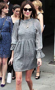 Alexa Chung wearing a grey Chanel dress.