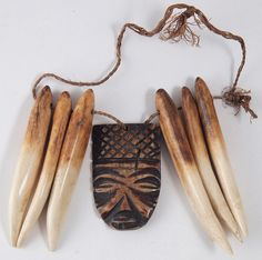Carved bone amulets, Cameroon by ann porteus, Sidewalk Tribal Gallery, via… Driftwood Jewelry, Wooden Jewelry, Handmade Jewelry, Popular Art, Arte Popular, African Jewelry, Tribal Jewelry, Sacred Symbols, Carving Designs