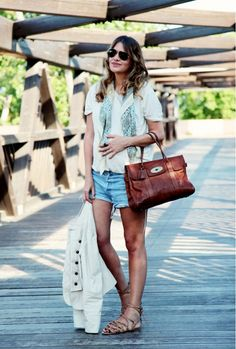 Denim cutoffs are paired with a Mulberry brown bag, strappy gladiator sandals, and a paisley printed silk scarf for a relaxed summer look