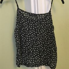 1 day sale! Brandy Melville floral tank Brandy Melville navy floral tank. Super soft and in great condition! Brandy Melville Tops Tank Tops