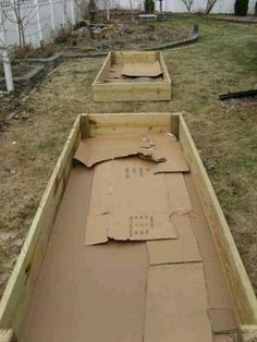 Raised bed gardens- a good idea to use cardboard as it keeps weeds down, and eventually decomposes to make worm friendly soil! :) (Add some worms to the top layer of soil, and give it a head start- they'll love the cardboard!)