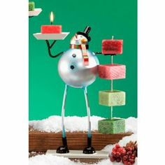"""Pack of 4 Metal Table Top Christmas Snowman Candle on Rope Holders 10"""" by CC Home Furnishings. $89.99. Pack of 4 Snowman Rope Candle HoldersItem #NAT2101You won't be able to stop feeling jolly when you see this long-legged metal snowman; the perfect accompaniment for the holiday candle on ropeHand sculpted and hand paintedEach tray holds (1) rope candle - not includedDimensions: 10""""H x 6.3""""W x 3.2""""DMaterial(s): metalPack includes 4 of the candle holder shown"""