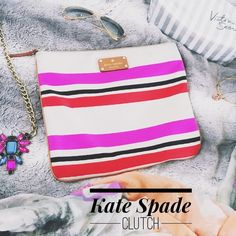 """Kate Spade Adrianne Clutch Kate Spade Adrianne Clutch in Oak Stripe! Authentic   I used this as my pencil case for school last semester so it's little dirty (mostly on the back, a couple little spots on the front, and around the zipper area but not very noticeable). So cute & it's a great deal!  Measurements: 11"""" by 9 1/2""""  kate spade Bags Clutches & Wristlets"""