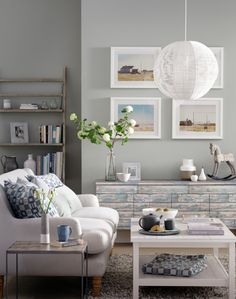 Create a winter coastal look with a soft-grey backdrop and white furniture. Turn a sideboard into a style statement with weathered, wood-effect wallpaper