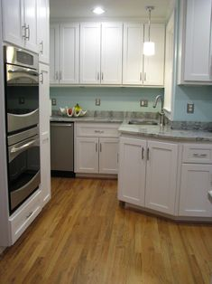 Beachnut Lane: Sherwin Williams' Tidewater, Sea Salt & Comfort Gray paint colors. I like the light aqua walls, white cabinets, silver counters and silver knobs/handles.
