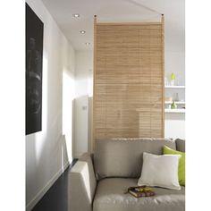 Cloison amovible Ennea.  Matière : En pin radiata (origine Espagne).  Dimensions : l.100 x h.240 cm. Epaisseur 35 mm.  Hauteur ajustable jusqu'à 2,5 m. 99E