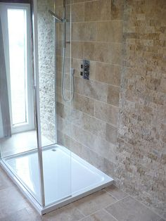 Travertine tile - I like the different sizes and textures.  Smaller tiles look like outdoor wall.