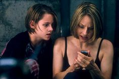 "Kristen Stewart with Jodie Foster portray the characters of Sarah and Meg Altman respectively in the movie ""Panic Room""....."