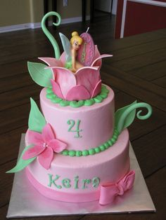 Fudge cake with pb filling and vanilla with strawberry filling, iced in buttercr. - Fudge cake with pb filling and vanilla with strawberry filling, iced in buttercream with fondant/gumpaste decorations. Tink is a candle. Tinkerbell Birthday Cakes, Fairy Birthday Cake, Birthday Cake Girls, Birthday Cupcakes, Tinkerbell Party, Tinkerbell Fairies, Princess Birthday, 4th Birthday, Birthday Ideas