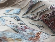 Russian illustrator and embroiderer Lisa Smirnova has created a dynamic portrait of a tattooed man with an Impressionistic feel to it.