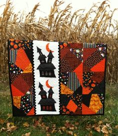 """My little boys call it the Scooby Doo quilt. One of my little boys said ""Mom I didn't know you could make boy quilts!"" Oops... I think I will be stitching up some ""boy"" quilts this winter!"" From A Farm Wife's Journal: Simply Haunting...Halloween Quilt #halloweenquilts #halloween #quilts"