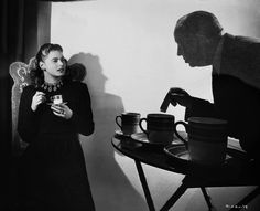 """On set of ""Notorious""(1946), Hitchcock shows Ingrid Bergman the proper method for poisoning a cup of coffee."" by __marlboroman__ in Moviesinthemaking"
