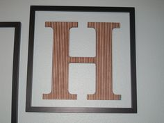 """""""H"""" letter on the wall"""
