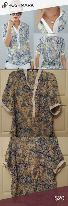Chiffon Floral Print Blouse Shirt Top NWOT Material: Chiffon USA size: XL/2XL Colors: blue, yellow, white Pattern has interesting blurred pattern. Back is slightly tighter and shorter.  Measurements: Shoulder to Shoulder: 17.5 in Chest: 47 in Length Front: 26.5 in Length Back: 22.5 in Length Sleeve: 10.5 in  Wash instructions: cold wash, hand or gentle cycle, air dry only. Tops Blouses