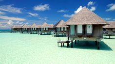 Stay at an over-water bungalow in the Maldives