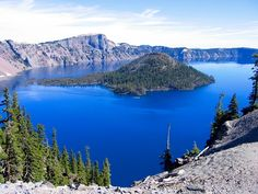 Crater Lake is a caldera lake located in Oregon, U.S.A., famous for its water clarity and deep blue color that looks like ink. Indian legend says that the mountain bluebird was gray before dipping into the waters of #CraterLake. Find more: http://impressivemagazine.com/2014/01/30/crater-lake-the-lake-with-the-most-intense-blue-color/