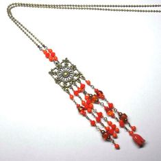 Collier sautoir en perles de verre orange chaine et par kalaniparis