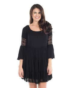 Chic and Unique! Stand out in stunning fashion when wearing this woman's mini dress with crochet laced details on the bell sleeves, body, and hem. The neckline stretches allowing to be worn in an off-the-shoulder style. A great one-of-a-kind choice!