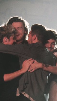 One Direction band group hug on the last On the Road Again concert in Sheffield…