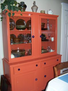 Up-Cycled vintage china cabinet. Found this in a little antique shop added a new coat of paint and some blue glass knobs.
