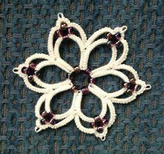 Tatted flower with beads. And this interpretation: http://leblogdefrivole.blogspot.com/2013/07/pretty-beaded-flower.html