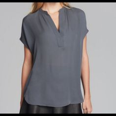 Vince Gray Cap Sleeve Popover Blouse Pretty gray blouse in silk. Some tiny pull marks as pictured which could possibly be fixed at an alterations place. Other than that, beautiful condition! Price reflects flaws. Semisheer georgette. Split neckline. Cap sleeves. Relaxed, flowy silhouette. Silk. Imported. The Chic Shed; A Current and Classic Fashion Curation.  10% OFF BUNDLES I ❤️ THE OFFER BUTTON ❌NO PP, TRADES, HOLDS❌  15% OFF RETURN BUYER BUNDLES Vince Tops Blouses