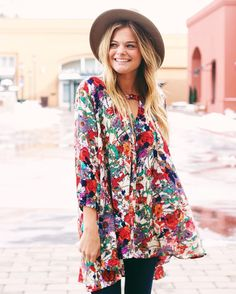 If you are looking for ways to add color to your wardrobe, look no further! This floral tunic belongs in your closet! $38