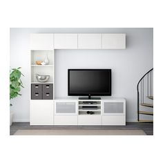 This gives you maximum storage and a modern built-in look for open feel. Would be fun to add in some of the colored doors.  BESTÅ TV storage combination/glass doors - white/Selsviken high-gloss/white frosted glass, drawer runner, push-open - IKEA