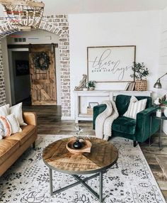 34 Comfy Living Room Decoration Ideas With Farmhouse Style and some velvety details This emerald green velvet sofa amazingly fit in the farmhouse styled decorated living area. Generally we don't use velvet sofas while creating a living room rustic. But for this example, that velvet sofa's just shining like a jewel.