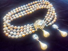 Check out this item in my Etsy shop https://www.etsy.com/listing/508063025/vintage-bridal-pearl-necklace-and