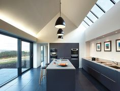 Skylights in the pitched roof bring additional natural light into the kitchen.