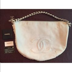 Chanel Modern Chain Hobo Calfskin Large White Chanel Modern Chain Hobo Calfskin Large. Crafted from white calfskin leather, woven-in leather chain strap, all-around chain link trims, stitched interlocking CC logo at its front, and gunmetal-tone hardware. Its top zip closure opens to a matching leather interior that includes side zip and slip pockets. Authenticity code 11201660. Marks on back of bag and on bottom surface. Minimal interior marks. Care booklets, authenticity card. Handle Drop…