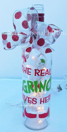 This listing is for 1 Lighted Wine Bottle. Decorative lighted wine bottles. Perfect to decorate your home or give as a gift. Each bottle is frosted, hole is in the back where the lights are. Lights are LED and are included.  The Grinch saying is a must have for all the Grinch fans on your list  We use only high grade vinyl for outdoor use.  Ribbon may vary, but will always match  Be sure to follow us on Facebook so you will know when we add new items to our Store…