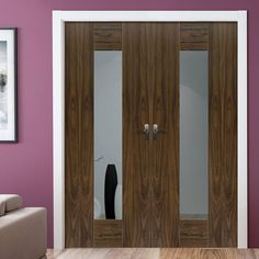 Jbk Symmetry Axis Walnut Door Pair with Clear Safety Glass is a fully pre-finished, well priced and unusual door pair ready to fit. #internalcontemporarydoors #walnutmoderndoorpair #contemporarymoderndoor