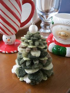 Cut up old sweaters, felt them, stack them, then you get a Christmas tree!