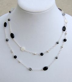 Long Sterling Silver and Onyx Station Necklace https://www.etsy.com/listing/126308898/station-necklace-long-sterling-silver