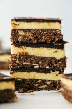 A stack of 3 nanaimo bars. Graham Cracker Crumbs, Graham Crackers, Lemon Icebox Cake, Delicious Desserts, Dessert Recipes, Nanaimo Bars, Custard Filling, Incredible Recipes, Unsweetened Cocoa