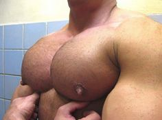 """caesarwv:  Brad could only moan as the man ran his hands over brad's huge pecs. """"Such beautiful pecs you have,"""" the older man whispered as he ran his thumbs under the stud's big cleavage.  Brad mindlessly bounced his big stabs of meats to the man's enjoyment.  """"Such a good boy.""""  The man pinched and twisted the huge pointed tits causing Brad's cock to swell in the tiny jockstrap."""