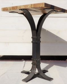 Reclaimed wood and welded iron pub table by GuyFurnitureGuy