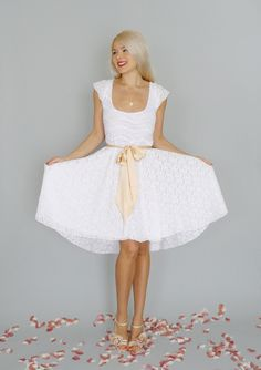 Sweet white dress for #bridal showers.  Imogen: White lace short reception dress with circle skirt & cap sleeves via Etsy.