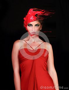 © Katrina Brown   Dreamstime.com- Woman With Paint Poured Onto Her Hair