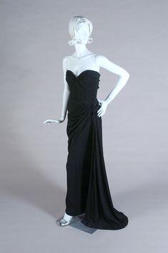 Strapless black taffeta evening gown with a fabric twist on the bodice, Adrian, ca. 1948-52, KSUM 1983.1.401.