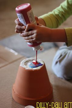 rainbow pour paint - terra cotta pot ..... I dot know what pour paint is but I am definitely going to familiarize myself with it to make this awesome craft